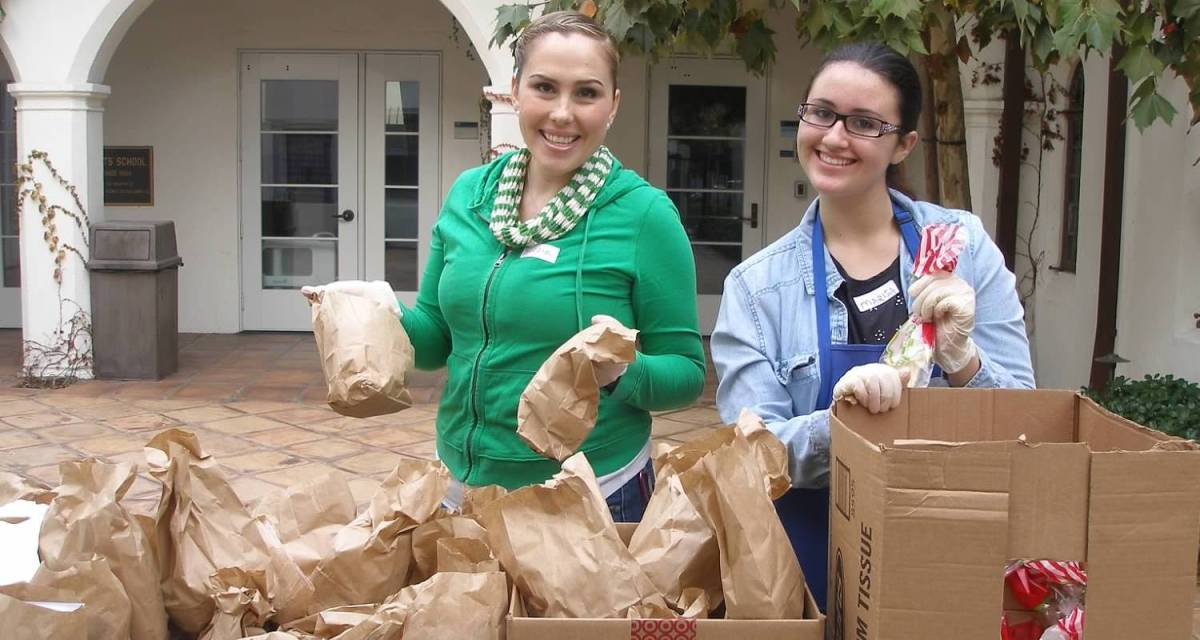 Serving bagged lunches to the needy